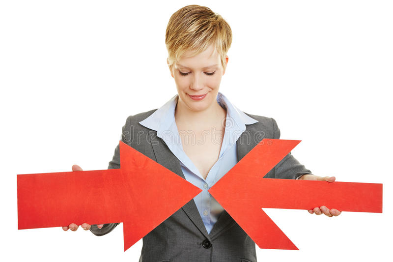 Business woman with two converging arrows royalty free stock images