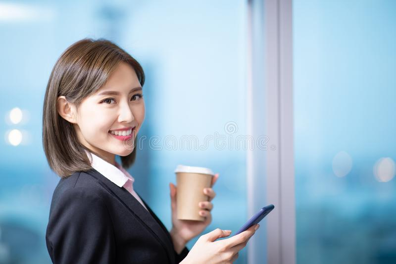 Business woman use smartphone stock photo
