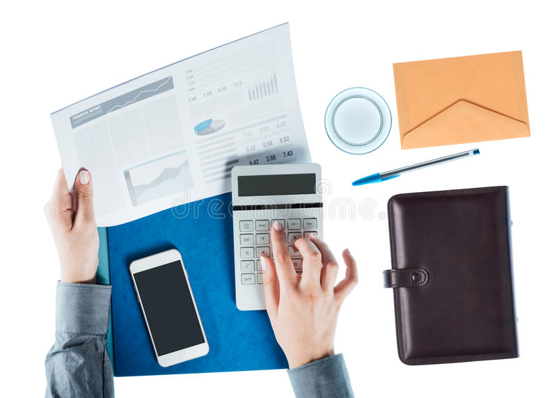 Business woman using a calculator stock photos