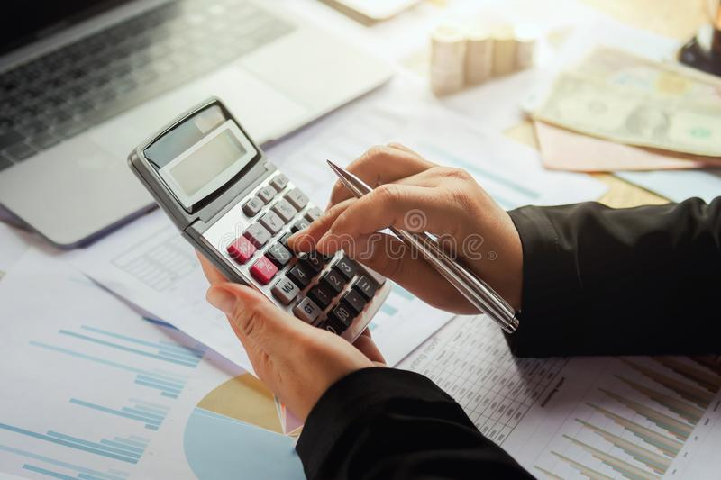 business woman using calculator for working in office. concept f royalty free stock photo