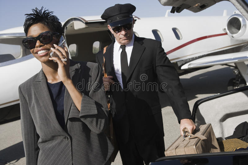 Business Woman Using Cellphone At Airfield stock image