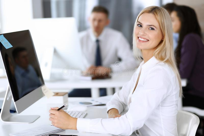Business woman using computer at workplace in modern office. Secretary or female lawyer smiling and looks happy. Working. Business women using computer at royalty free stock photos