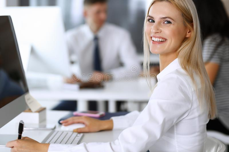 Business woman using computer at workplace in modern office. Secretary or female lawyer smiling and looks happy. Working. Business women using computer at royalty free stock photography