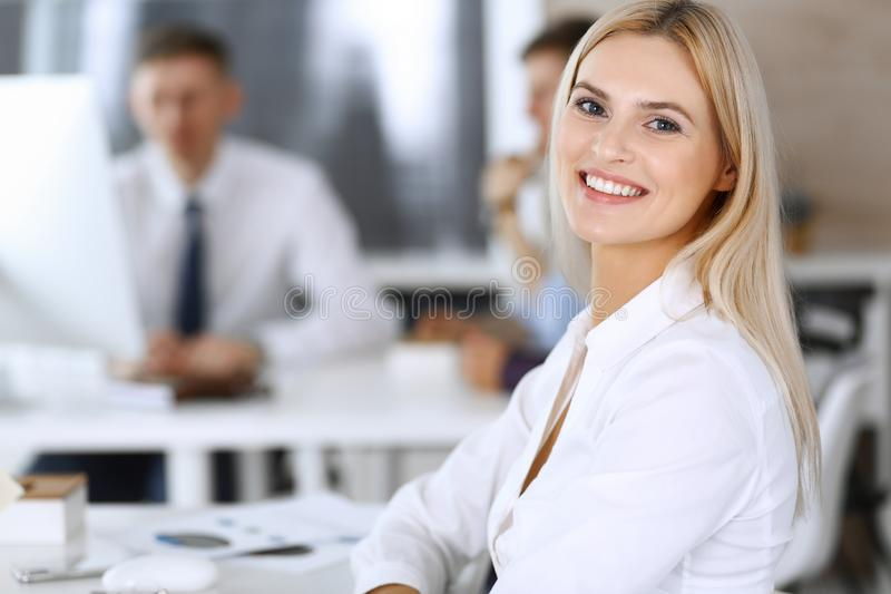Business woman using computer at workplace in modern office. Secretary or female lawyer smiling and looks happy. Working. Business women using computer at stock photography