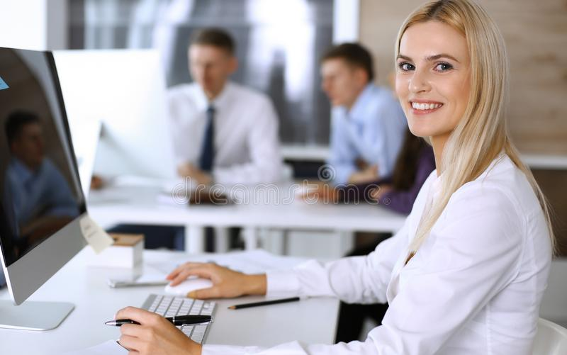 Business woman using computer at workplace in modern office. Secretary or female lawyer smiling and looks happy. Working. Business woman using computer at stock photos