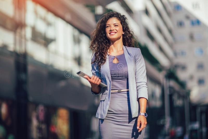 Business woman using digital tablet outdoor stock photography