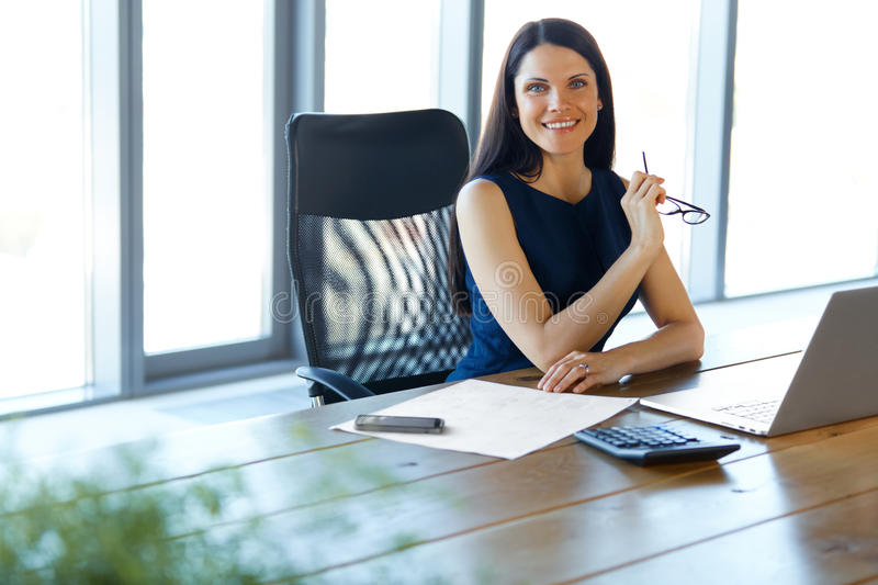 Business Woman using her Laptop Computer at office. Business Peo. Ple royalty free stock photo