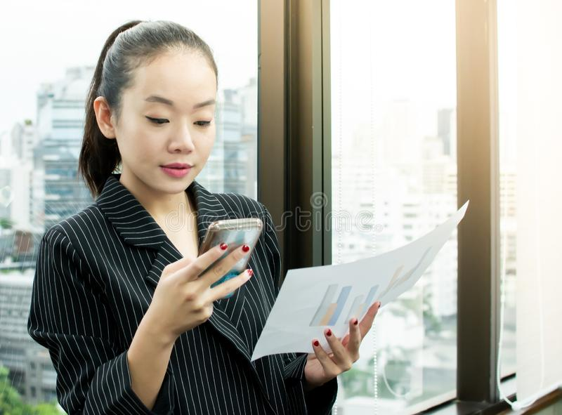 A business woman using her mobile phone for working royalty free stock photography