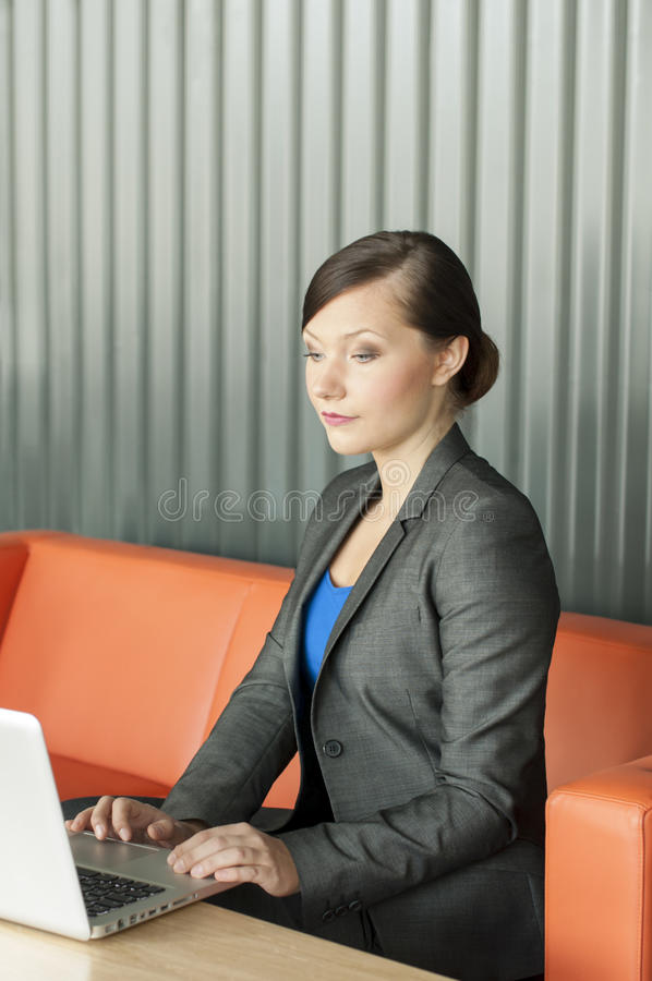 Business woman using a laptop stock photos