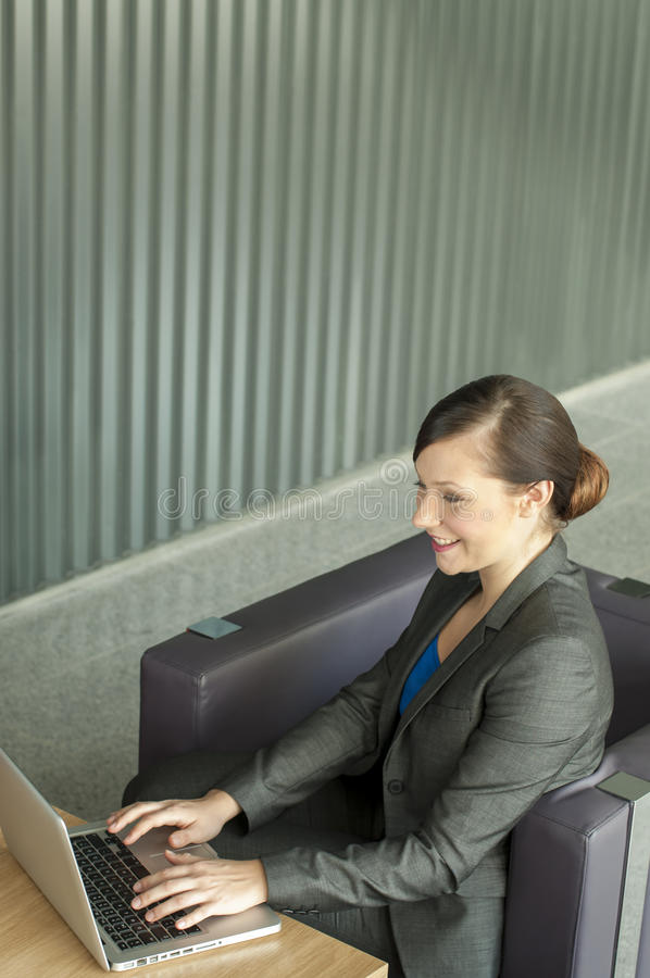 Business woman using a laptop royalty free stock image