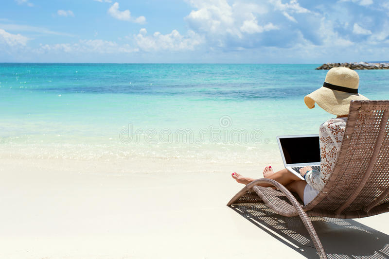 Download Business Woman Using Laptop Computer On The Beach Stock Photo - Image of distance, island: 55279496