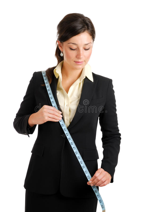 Download Business Woman Using A Measuring Tape Stock Image - Image: 10468737