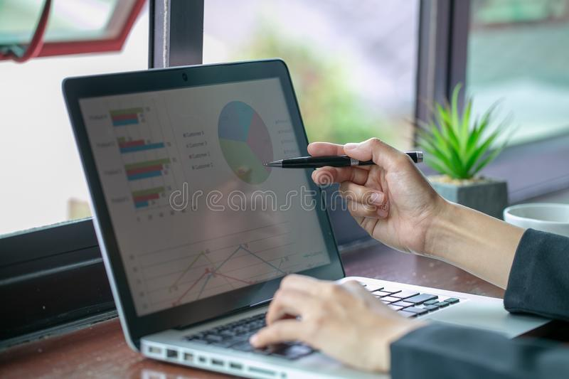 Business woman using modern laptop with graph. Business startup. Analyze strategy concepts royalty free stock photo
