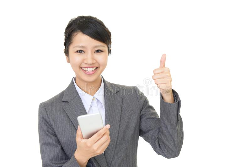 Business woman using a smart phone royalty free stock photos