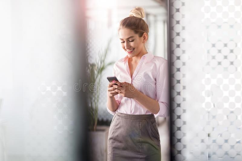 Business woman using smartphone in office stock image