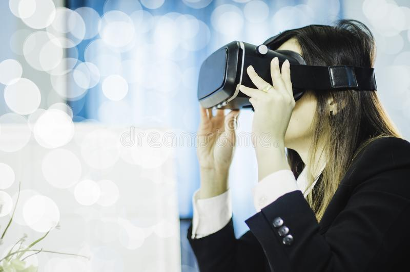 Business Woman using a VR headset for work with virtual reality, with fun and happy new experience, Concept of modern technologies royalty free stock photos