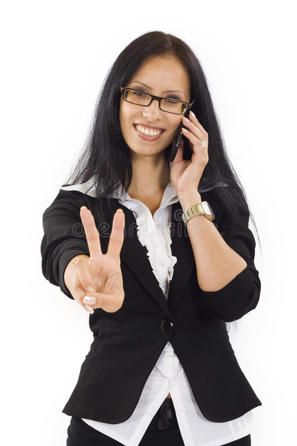 Business woman with victory gesture. And mobile phone royalty free stock photo
