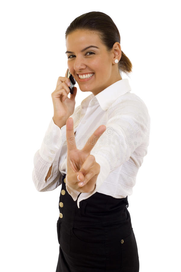 Business woman with victory gesture. And mobile phone royalty free stock photography
