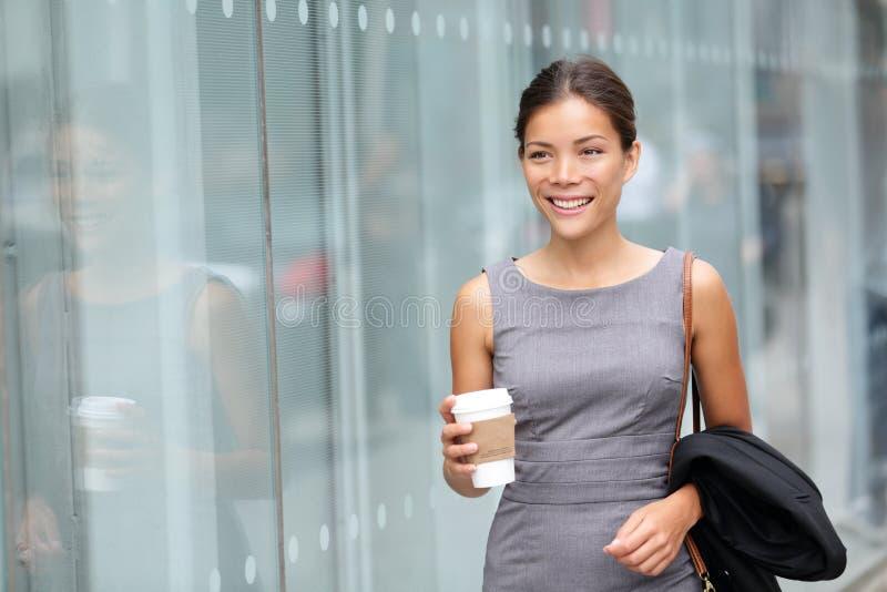 Business woman walking drinking coffee stock photo