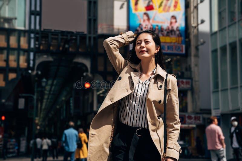 Business woman walking flicks hair royalty free stock photography