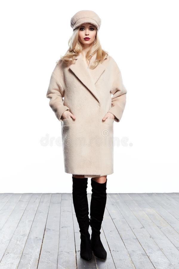 Business woman wear casual clothes style for winter autumn fashion model natural cashmere wool beige coat accessory hat blond royalty free stock image