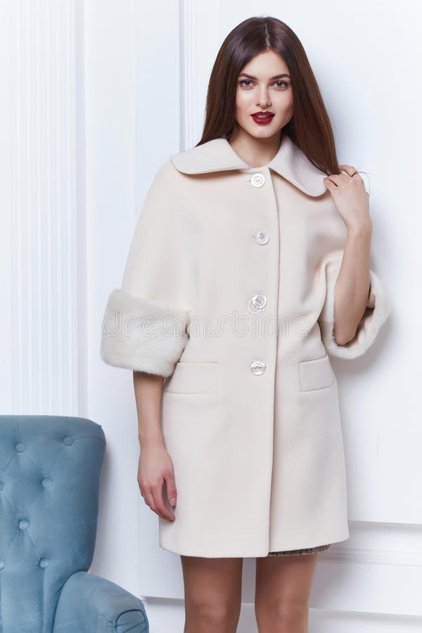 Business woman wear casual clothes style for winter autumn. Fashion model natural cashmere wool coat brunette hair glamour trend studio white background trench royalty free stock photos