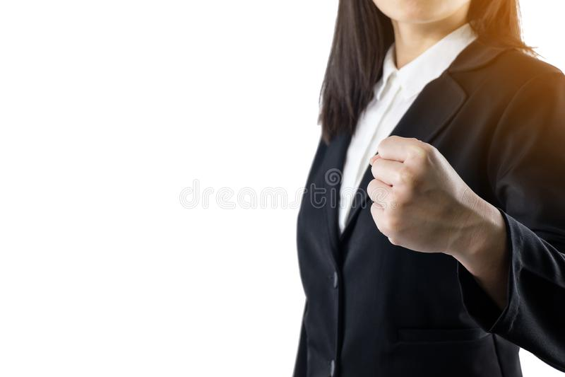 Business woman wearing black suit standing show handful of achievements isolated on white background.She is confident of success. stock photography