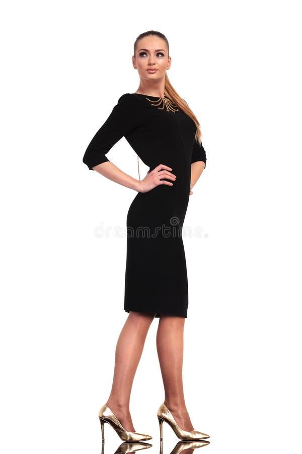 Business woman wearing a elegant black dress stock image