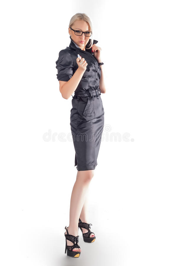 Business woman whith pen. In hend wearing glasses over a white background stock photo