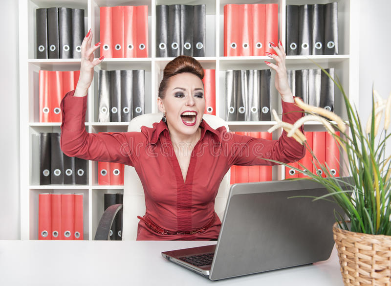 Business woman winner. Happy smiling business woman with her arms in the air royalty free stock images