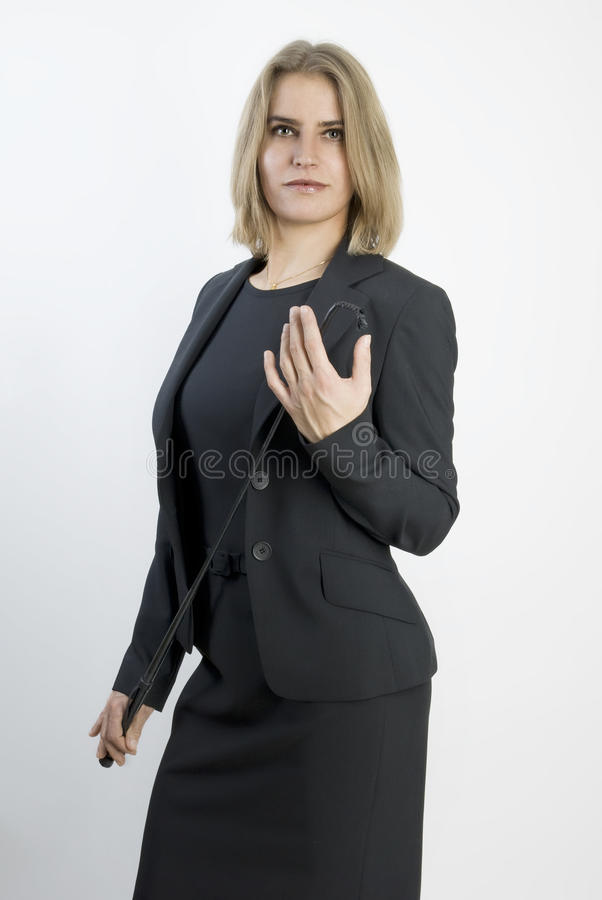 Free Business Woman With A Whip In Her Hands. Royalty Free Stock Photography - 17613397