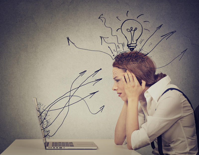 Business woman working on computer in her office stock photography