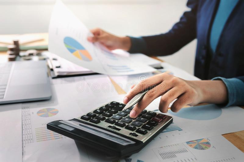 .Business woman working in finance and accounting Analyze financial budget in the office royalty free stock photo