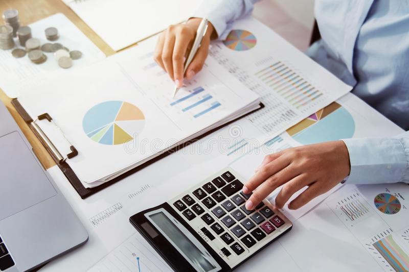 .Business woman working in finance and accounting Analyze financial budget in the office stock photo
