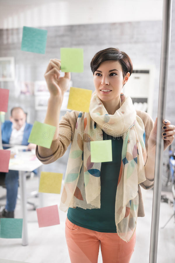 Business woman working in graphic studio. Young business women working in graphic studio royalty free stock photos