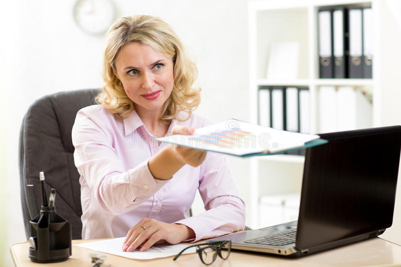 Business woman working at her workplace in office royalty free stock photography