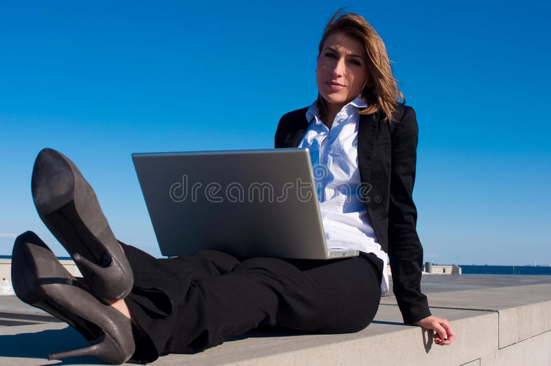 Business woman working with laptop, close stock photography