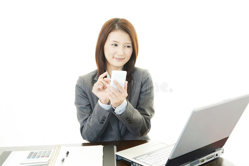 Business woman working on laptop. The female office worker who poses happily royalty free stock photos