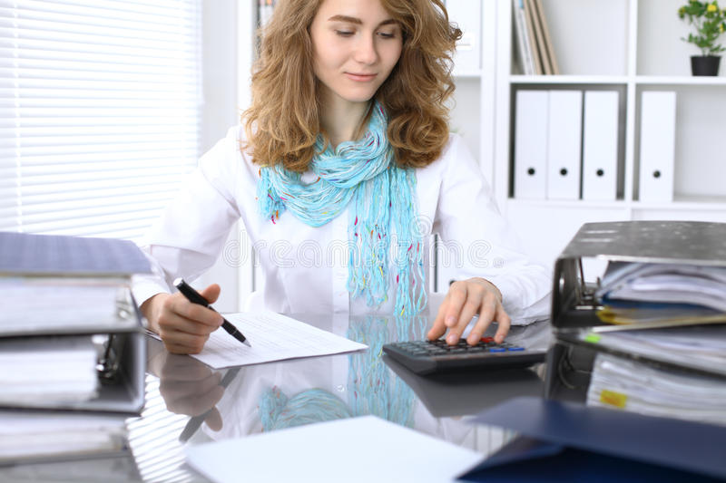 Business woman working with laptop in the office. Audit concept.  stock photography