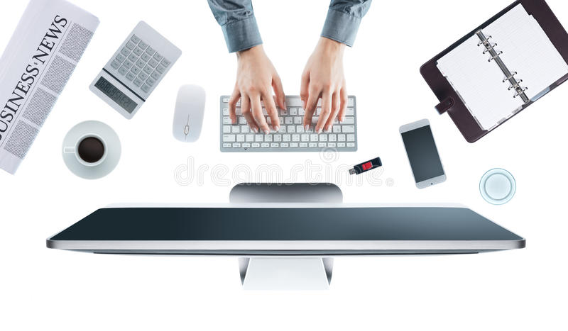Business woman working at office desk royalty free stock photo