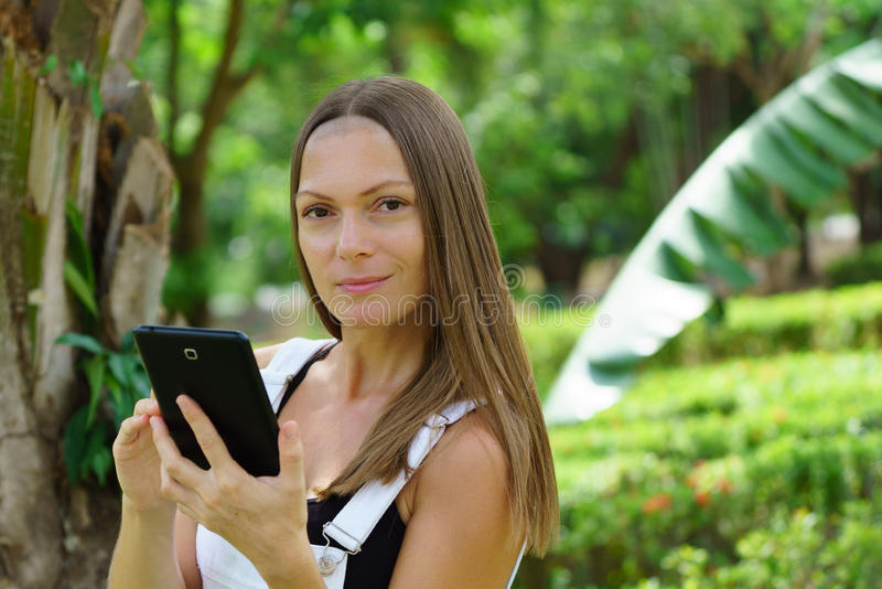 Business woman working in the park. In the sunny day in Thailand stock photography
