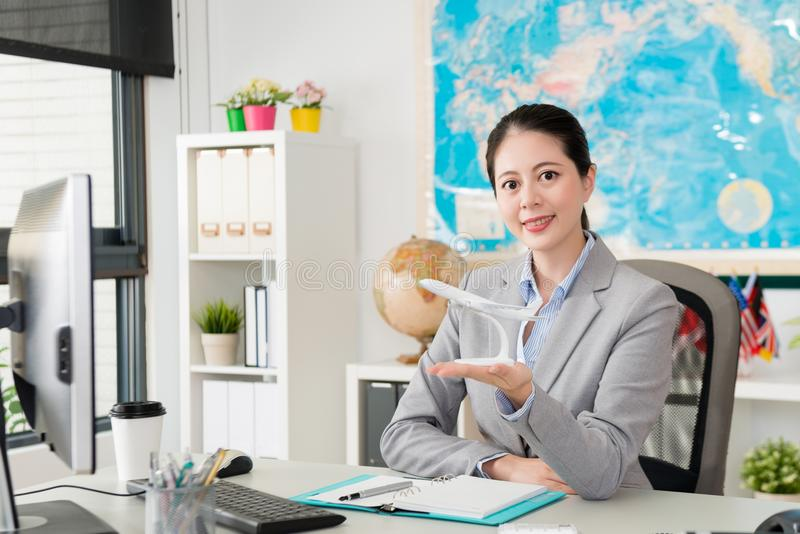 Business woman working on travel agent company stock photography