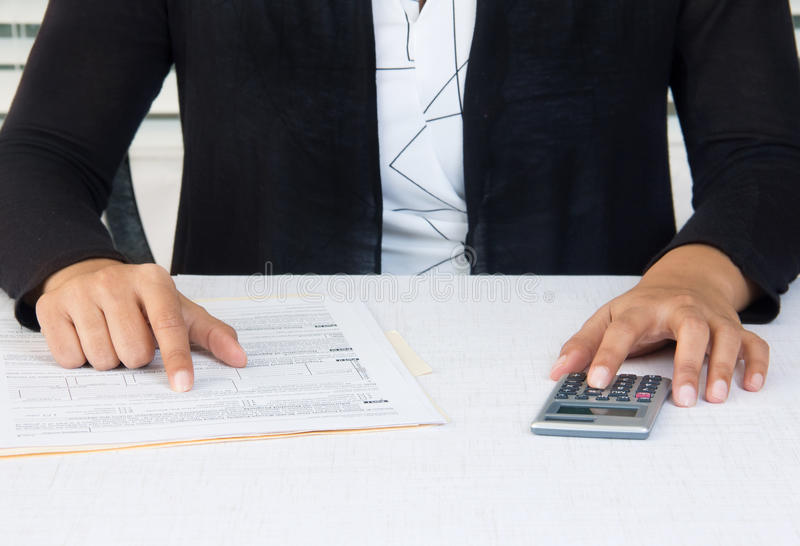 Business woman at workplace working on financial accounts stock photography