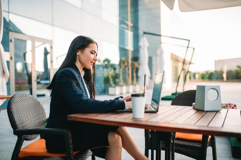 Business woman works on laptop in office stock photo