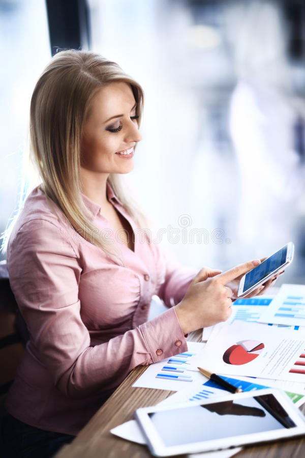 Business woman works with modern devices stock photography
