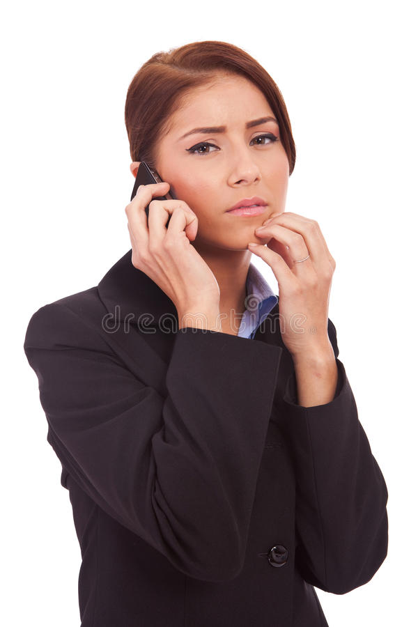 Business woman worries onthe phone royalty free stock image