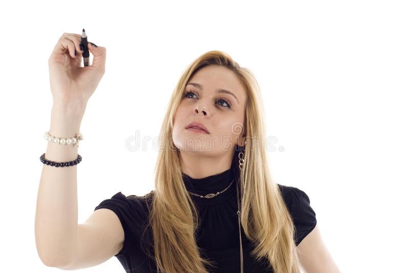 Business Woman Writing. A business woman is writing a business plan and looking into the camera on a white isolated background royalty free stock photo