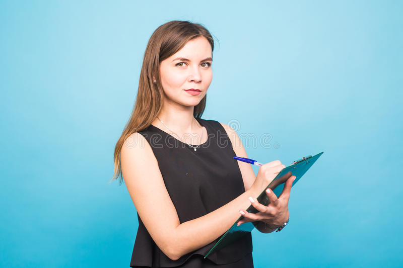 Business woman write on clipboard stock photos