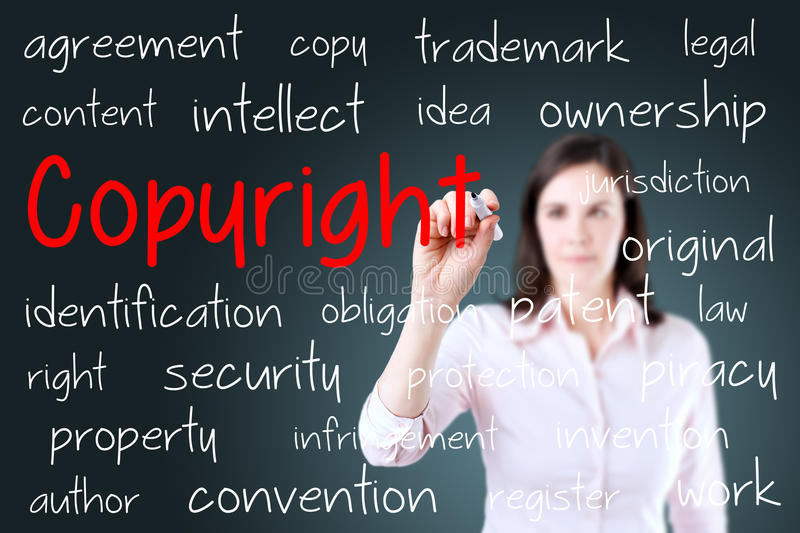 Business woman writing copyright concept. Blue background. royalty free stock photo