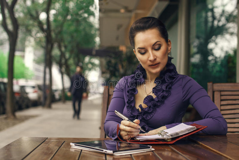Business woman writing in the sketch book stock photography